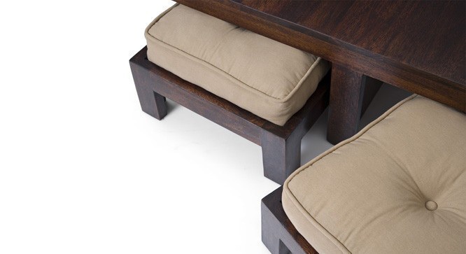 The stools can be compactly nested under the table for a clutter free look